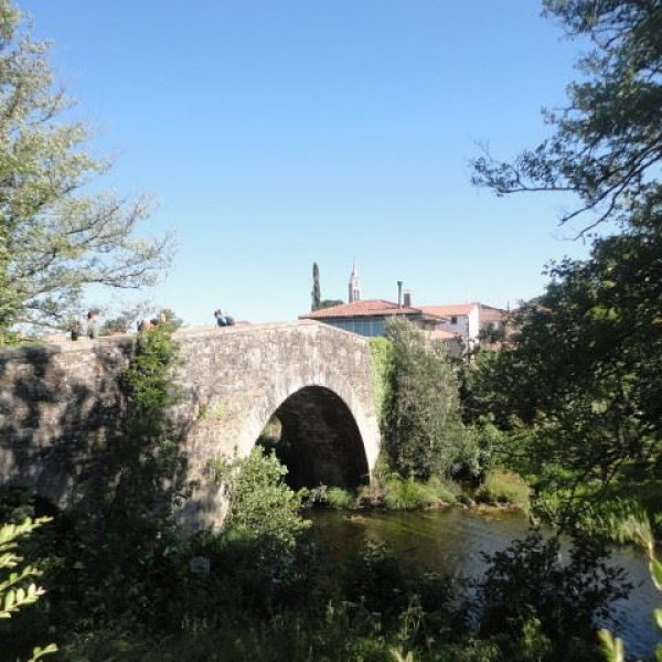Medieval bridge at the entrance to Furelos.