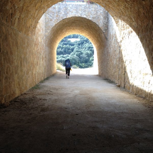 Pilgrim in Camino Tunnel