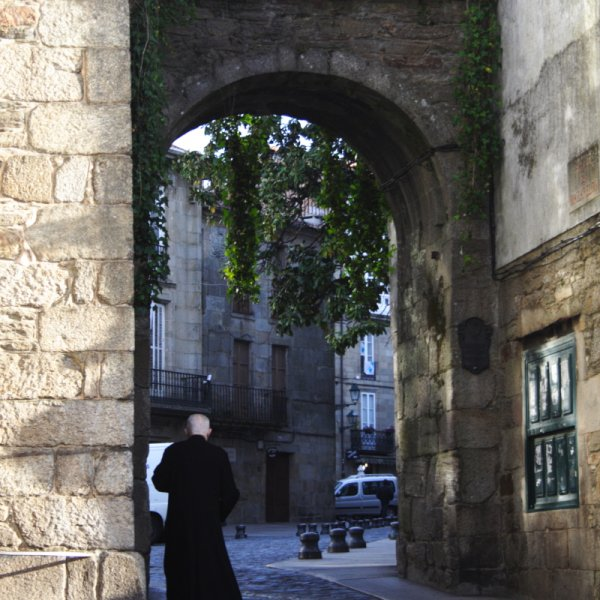 Priest at gate