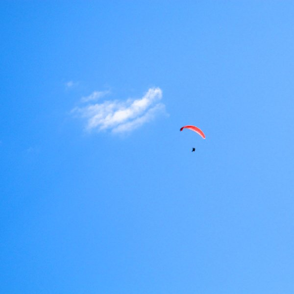 Paraglider being chased by a cloud